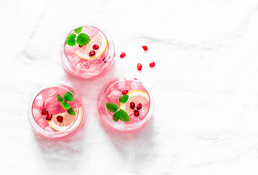 Pomegranate tequila cocktail. Summer light alcoholic drink,  cooling aperitif. On light background, top view, free space. Flat lay 949446594