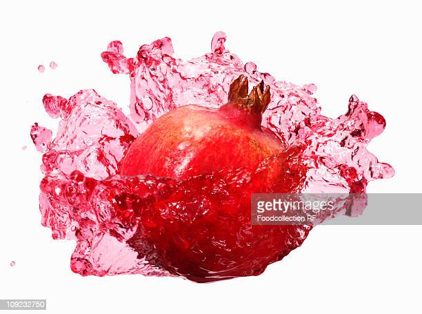 Pomegranate with splashing pomegranate juice