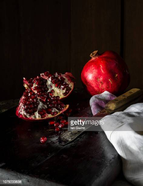 pomegranates and knife - ian gwinn stock photos and pictures