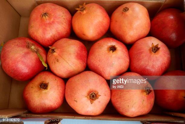 pomegranates at the market - sharon plain stock pictures, royalty-free photos & images