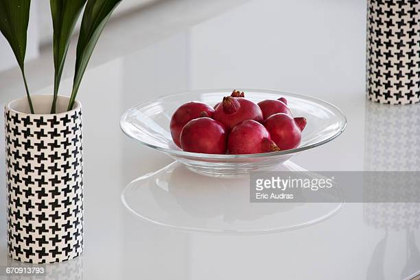 Pomegranates in plate on table