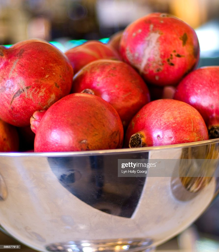 Pomegranates in silver bowl : Stock Photo