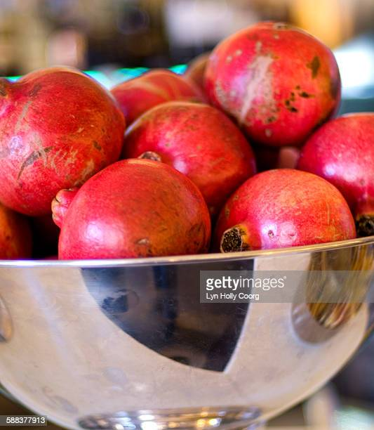 pomegranates in silver bowl - lyn holly coorg stock photos and pictures