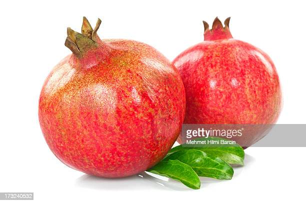 pomegranates with leaves - pomegranate stock pictures, royalty-free photos & images