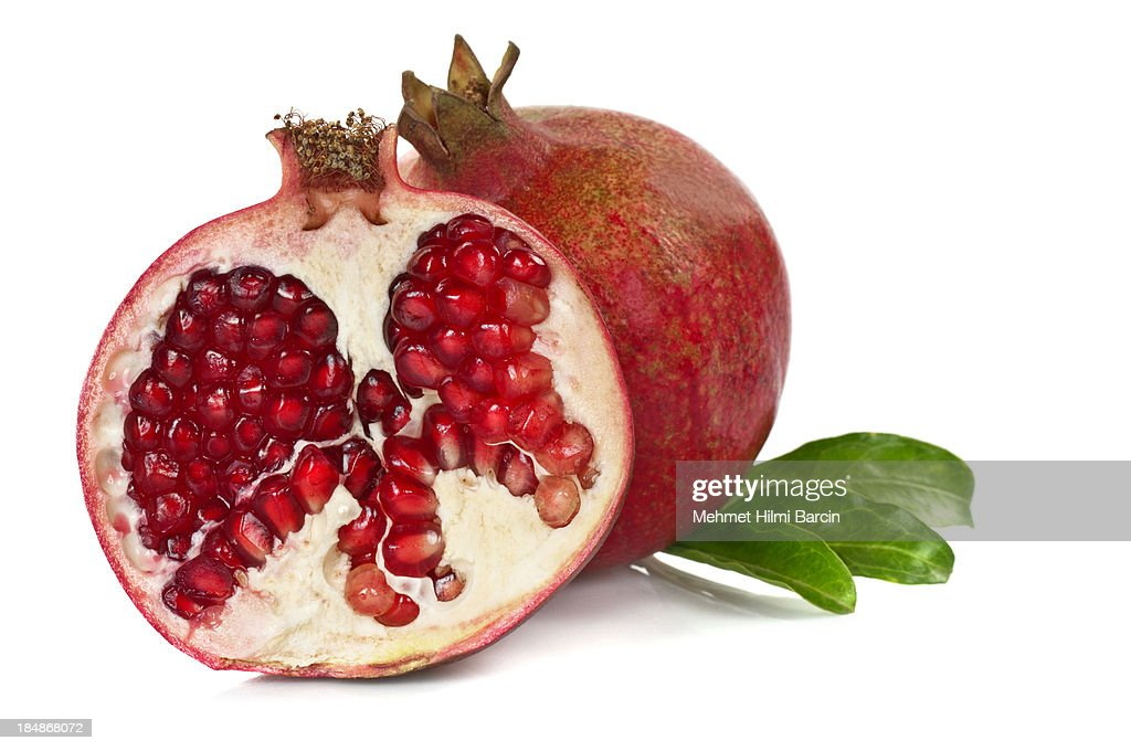 Pomegranates with Leaves : Stock Photo
