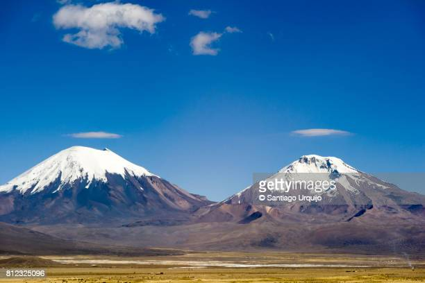 pomerape and parinacota volcanoes - stratovolcano stock photos and pictures