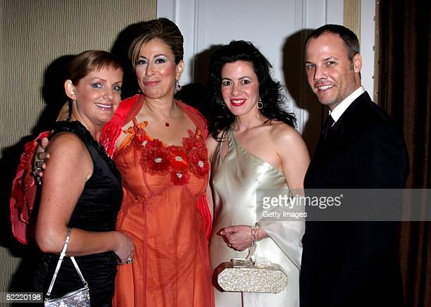 JL Pomeroy Actress Roma Maffia Jacqueline Mazarella and Christopher Grubb pose during the 7th Annual Costume Designers Guild Awards VIP Reception at...