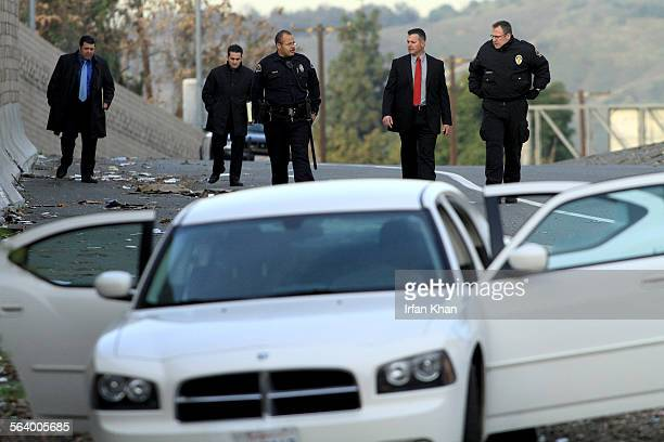 Pomona police crime scene investigators search for evidence near a car on White Avenue offramp of East bound I10 where man was found fatally shot...