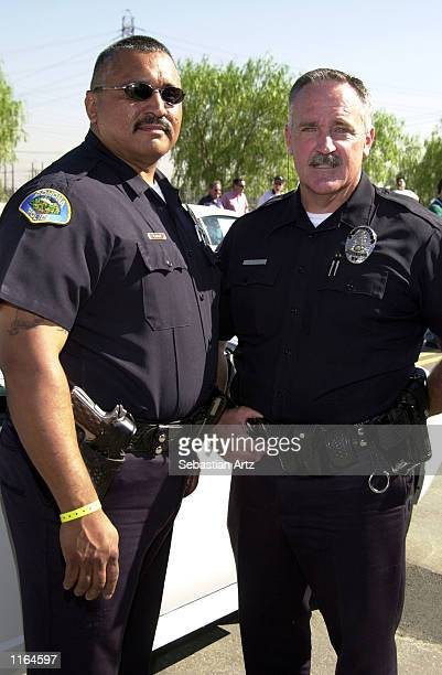 Pomona Police Officers J Mada and W Luemmen get ready to participate in drag races where celebrities compete against police officers September 29...