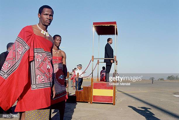 Pomp and ceremony at Matsapa airport as His Majesty King Mswati III arrives back in Swaziland from a state visit to Kenya The King stands on a podium...