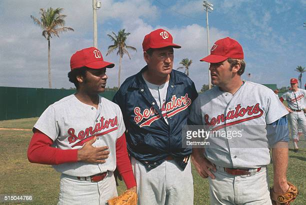 Pompano Beach Florida Washington Senators' manager Ted Williams gets together with two of newly acquired ball players Curt Flood and Denny McLain at...