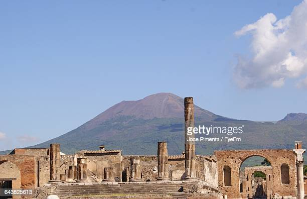Pompeii And Mount Vesuvius Against Blue Sky