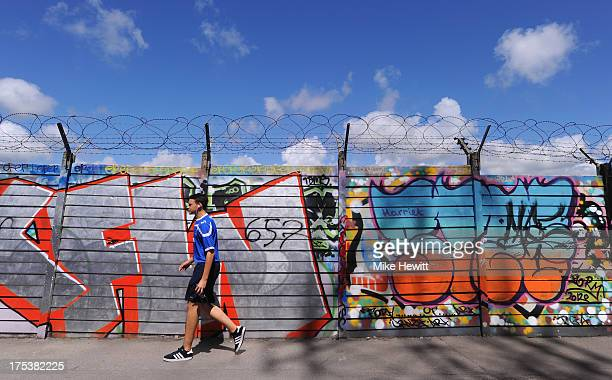 Pompey fan walks down an alley behind Fratton Park ahead of the Sky Bet League Two match between Portsmouth and Oxford United at Fratton Park on...