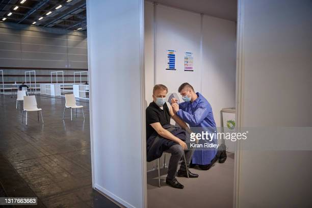 Pompier administers a Covid-19 vaccination at Paris' latest mass-vaccination centre at the National Exhibition Centre on the first day that Covid-19...