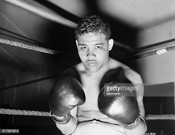 """Pompton Lakes, NJ - Just take a look at these two mighty """"pile drivers"""" which Heavyweight Champion Joe Louis exhibits in this unusual closeup at his..."""