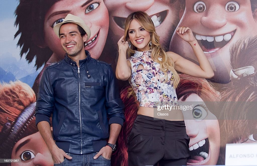 Poncho Herrera (L) and Eiza Gonzalez (R) pose for a photo during a press conference to present the movie Los Croods on March 14, 2013 in Mexico City, Mexico.