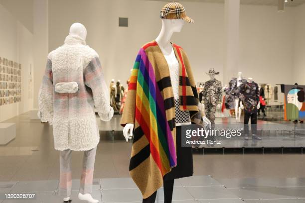 Poncho, top, skirt and cap by Burberry and Christopher Bailey is seen during the exhibition Dress Code: Are You Playing Fashion? - A collection of...
