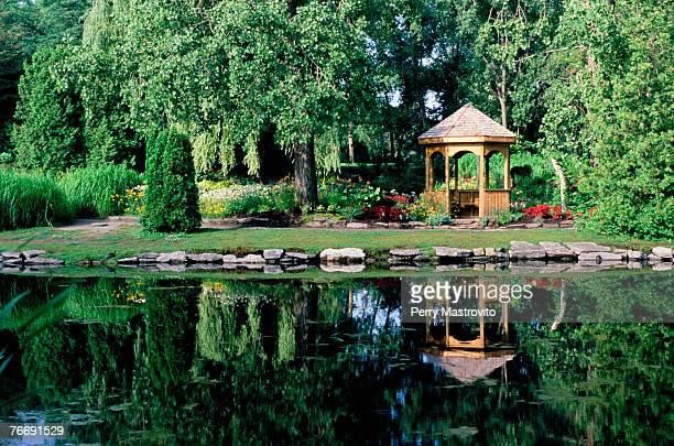 pond and garden at centre-de-la nature, laval, quebec, canada - laval canada stock pictures, royalty-free photos & images