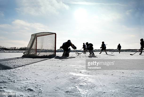 pond hockey - hockey player stock pictures, royalty-free photos & images