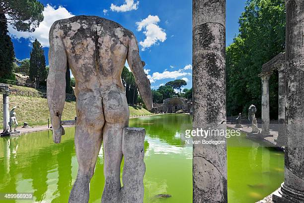 Pond surrounded with colonnade and statues at Hadrian's Villa , a large archeological site in Tivoli, Italy.