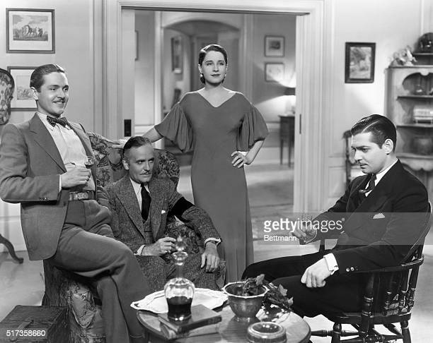 'MY THREE MEN ALL HERE' ponders Norma Shearer in this scene with Alexander Kirkland Ralph Morgan and Clark Gable from MetroGoldwynMayer's 'Strange...
