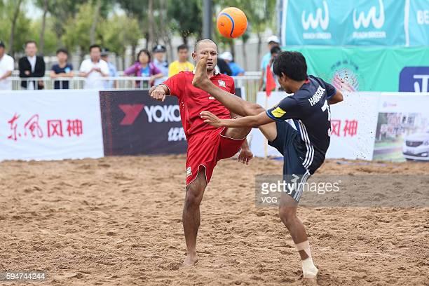 Pongsak Khongkaew of Thailand competes for the ball with Shotaro Haraguchi of Japan during the Continental Beach Soccer Tournament match between...