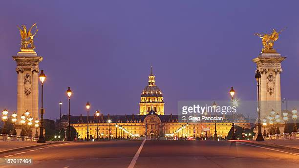 pont alexandre iii and les invalides at night - les invalides quarter stock photos and pictures