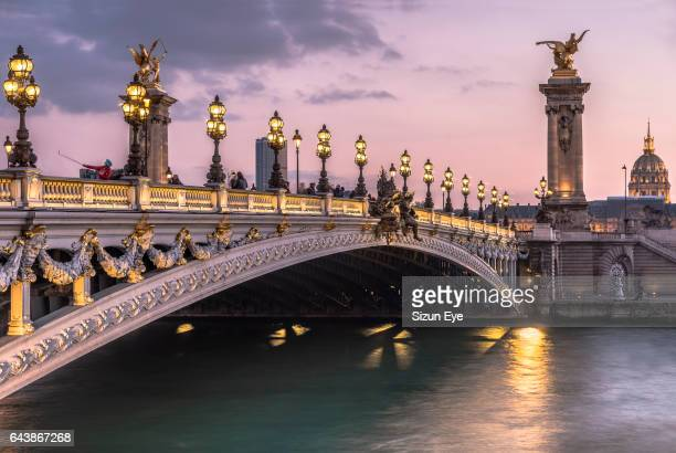 Pont Alexandre III at twilight in Paris, France.