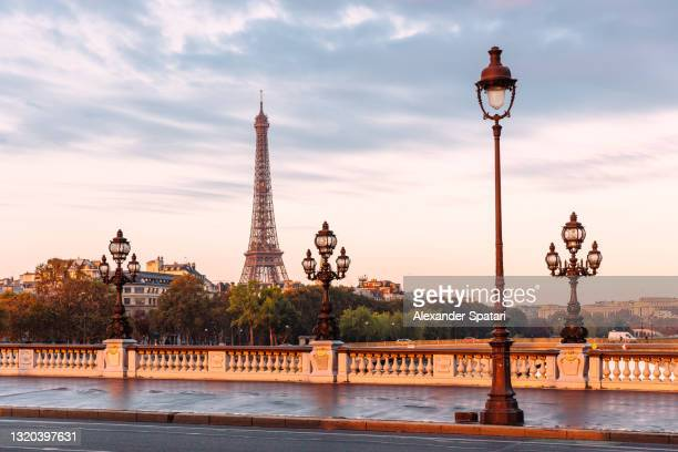 pont alexandre iii bridge and eiffel tower at sunrise, paris, france - les invalides quarter stock pictures, royalty-free photos & images