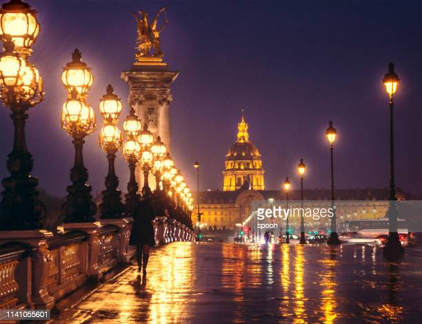 pont alexandre iii by night, looking towards les invalides. paris, france. - paris night stock pictures, royalty-free photos & images