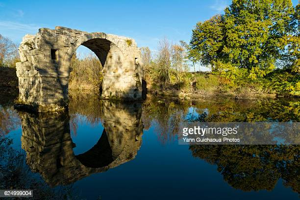 pont d'ambroix, roman bridge at ambrussum, villetelle, herault,languedoc roussillon, france - herault stock pictures, royalty-free photos & images