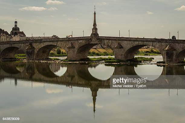 Pont De Blois Bridge With Reflection In Loire River Against Sky