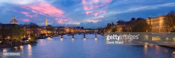 pont des arts at night - river seine stock pictures, royalty-free photos & images