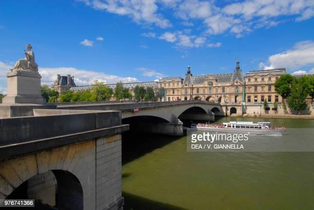 Pont du Carrousel a boat on the Seine the Louvre Paris France