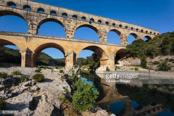 Pont du Gard Vers PontduGard Gard Department LanguedocRoussillon France Roman aqueduct crossing Gardon River Pont du Gard is a UNESCO World Heritage...