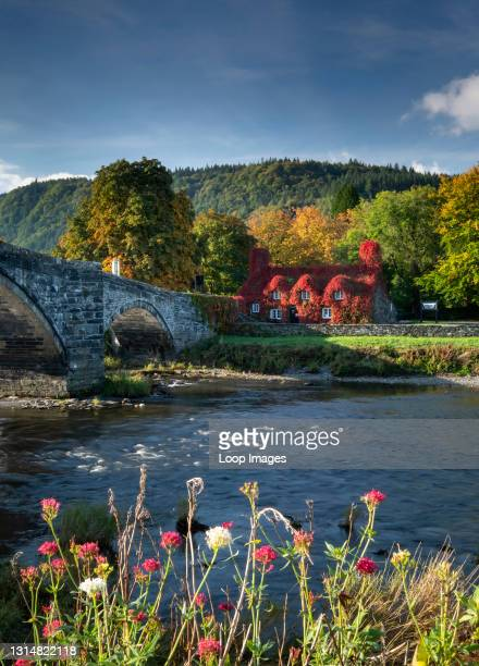 Pont Fawr with Tu Hwnt I'r Bont and the River Conwy at Llanrwst in Snowdonia.