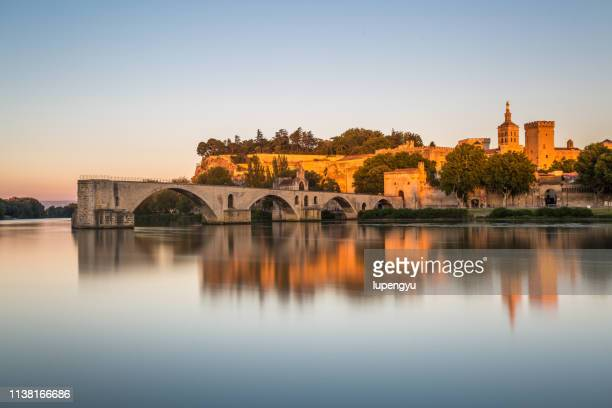 pont saint-benezet on rhone river and avignon cathedral at sunset,avignon - rhone stock pictures, royalty-free photos & images