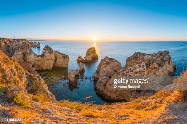 ponta da piedade at sunrise, algarve, portugal - faro stock pictures, royalty-free photos & images