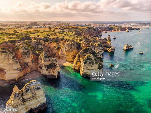 ponta da piedade cliffs  aerial view in algarve, portugal - portugal stock pictures, royalty-free photos & images