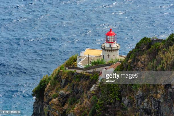 ponta do arnel lighthouse on the northeast coast of the island of são miguel in the azores. - archipelago stock pictures, royalty-free photos & images