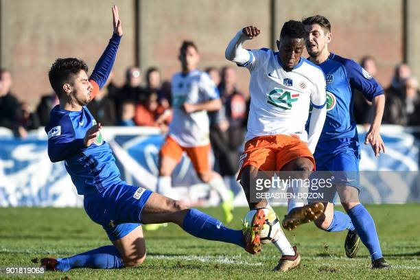 Pontarlier's French defender Xavier Da Rocha vies with Montpellier's French forward Isaac Mbenza during the French Cup football match between...