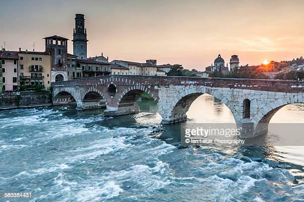 Ponte Pietra on Adige river, sunset, Verona, Italy