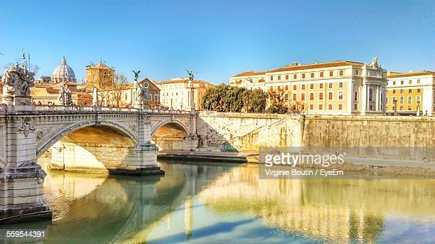 Ponte Sant Angelo Over River Against St Peter Basilica And Clear Sky