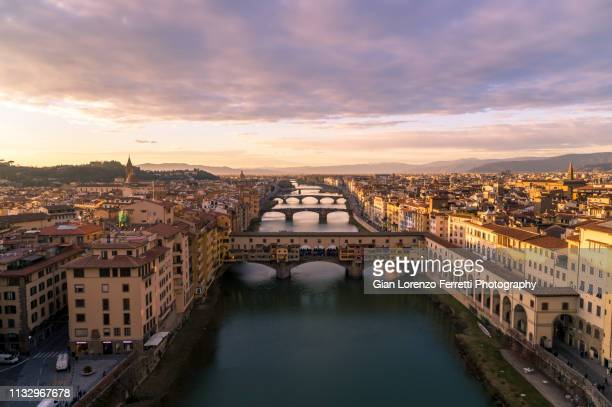 ponte vecchio at dusk - florence italy stock pictures, royalty-free photos & images