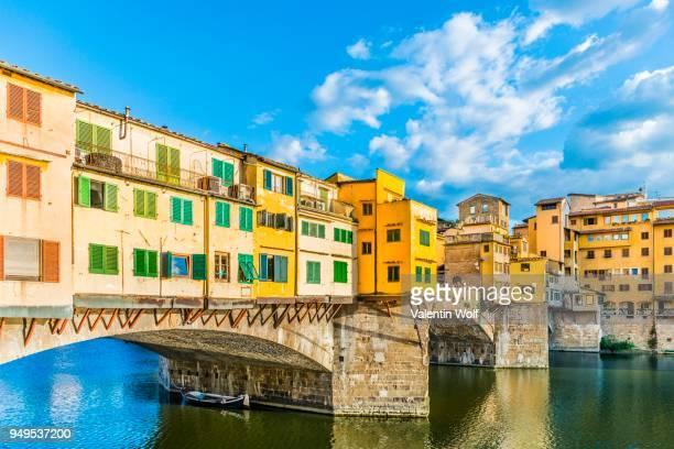 ponte vecchio bridge over arno river, florence, tuscany, italy - ponte vecchio stock photos and pictures