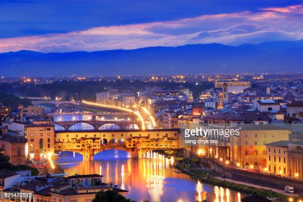 ponte vecchio, florence at dusk - florence italy stock pictures, royalty-free photos & images