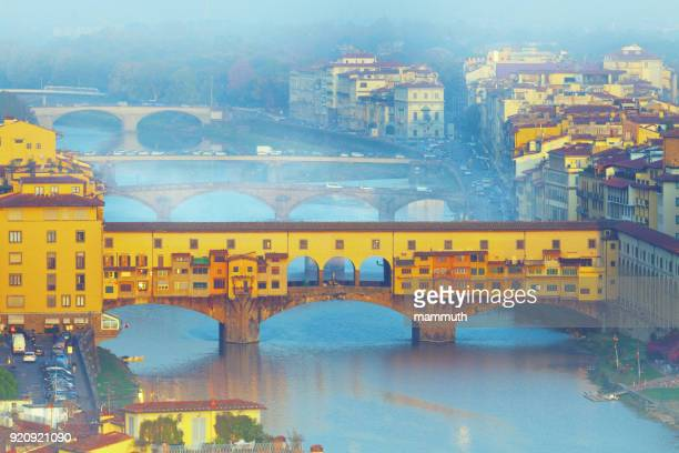 ponte vecchio in florence in a foggy morning - tuscany, italy - ponte vecchio stock photos and pictures