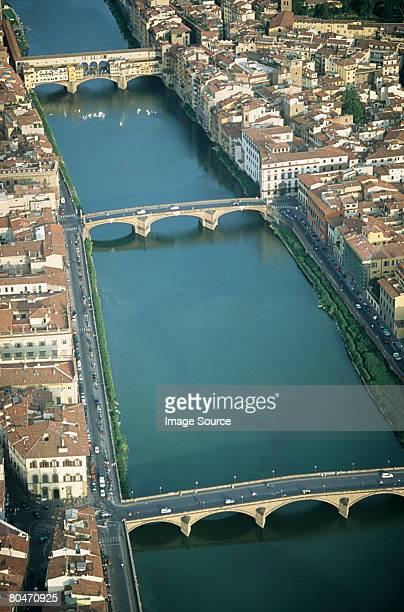 ponte vecchio over arno river  - ponte vecchio stock photos and pictures