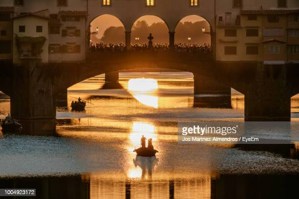 ponte vecchio over canal - florence italy stock pictures, royalty-free photos & images