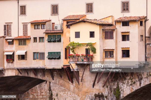 ponte vecchio over the river arno in the city of florence. - renaissance stock pictures, royalty-free photos & images